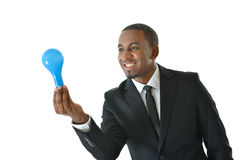 Business Idea. Businessman holding lightbulb representing a new business idea or concept Royalty Free Stock Images