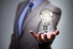 Business idea. Businessman with illuminated light bulb concept for idea, innovation and inspiration Stock Photography
