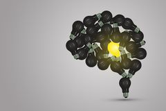 One yellow light bulb locate in middle of the brain surrounded with many black light bulb. royalty free stock photography