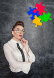 Business Idea concept. Woman looking on puzzle Royalty Free Stock Images