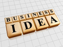 Business idea in golden cubes. 3d golden cubes with black letters with text - business idea Royalty Free Stock Images