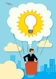 Business Idea. A large thought bubble containing a light bulb, that is lifting up a businessman over the city. A metaphor for ideas, imagination and opportunites Royalty Free Stock Photography