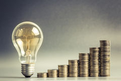 Business idea. Light bulb with heap of coins stairs for financial plan or business idea concept Stock Photo