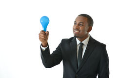 Business Idea. Business man holding blue light bulb representing new business idea or concept Stock Image