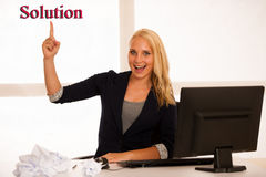 Business idea and success - woman behind the desk in office poin. Ting up in copy space as gesture of good results Stock Image