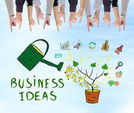 Business ideas concept on a wall. Business ideas concept pointed by several fingers Royalty Free Stock Image