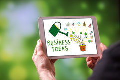 Business ideas concept on a tablet. Man holding a tablet showing business ideas concept Royalty Free Stock Images