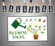 Business ideas concept on a whiteboard. Hands holding writing slates with arrows pointing on business ideas concept Stock Images