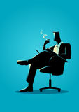 Businessman sitting and reading on a chair while smoking Royalty Free Stock Photo