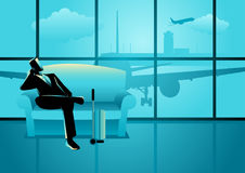 Businessman waiting his flight at the airport Royalty Free Stock Photos