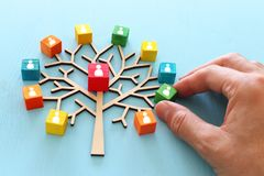 Business image of wooden tree with people icons over blue table, human resources and management concept.  royalty free stock images