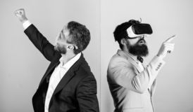 Business implement modern technology. Man with beard in VR glasses and louvered plastic accessory. Guy interact in. Virtual reality. Hipster exploring virtual royalty free stock photos