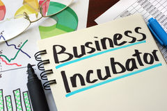 Business Incubator. Business Incubator written on a notepad with marker Royalty Free Stock Photo