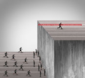 Business Innovation Advantage. Concept as a group of businesspeople running into a high wall obstacle with one clever competitive businessman using a ladder to Stock Photos