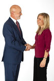 Business - inspiring confidence. Senior business man inspiring confidence to a young female while holding her hand (isolated on white Stock Photos