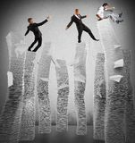 Business instability. Business men of unstable piles of paper Royalty Free Stock Photo