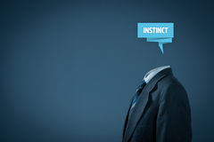 Business instinct. Successful manager has business instinct. Businessman with label representing brain and text instinct Royalty Free Stock Photo