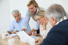 Business instructor with group of seniors Stock Photo