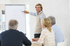 Business instructor leading meeting with seniors Royalty Free Stock Photography