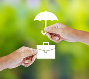 Business insurance concept. With an umbrella covering business briefcase Royalty Free Stock Image