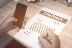 Business insurance lawyer concept : hand using pen sign business Stock Photography