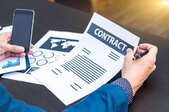 Business insurance lawyer concept : hand using pen sign business Stock Photos