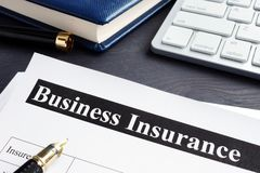 Business insurance policy and pen stock photography