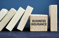 Business insurance written on the wooden cube and blocks royalty free stock images