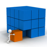 Business integration. Concept, white male figure pushing a cube into perfect formation of cubes, making a larger one Stock Photo
