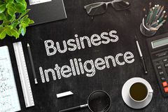 Business Intelligence on Black Chalkboard. 3D Rendering. Royalty Free Stock Photo