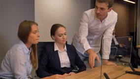 Few businesspeople work with transparent glass interface display. stock video footage