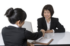 Business interview. Portrait of Asian businesswoman shaking hands with colleague Stock Photo