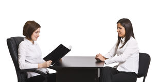 Business interview. Two businesswomen at an interview in an office isolated against a white background Royalty Free Stock Photo