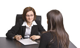 Business interview. Two businesswomen at an interview in an office.The documents on the desk are mine Royalty Free Stock Photos