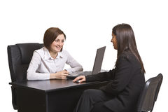 Business interview. Two businesswomen at an interview in an office.The documents on the desk are mine Royalty Free Stock Images