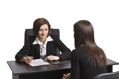 Business interview. Two businesswomen at an interview in an office.The documents on the desk are mine Stock Photos