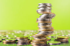 Business and investment financial concept. Money coins on table with trading graph background. Stock Photography