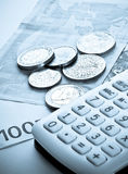 Business, investments. Euro banknotes 100, coins and calculator Stock Photo