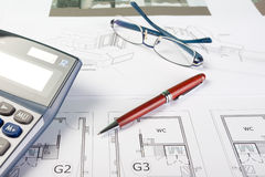 Business items and architect drawings Royalty Free Stock Images