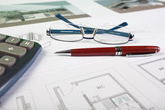 Business items and architect drawings Royalty Free Stock Photography