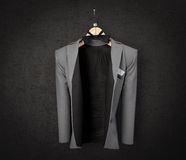 business jacket on textured wall concept photo background Royalty Free Stock Photography