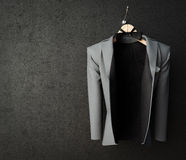 Business jacket on textured wall concept photo background Stock Photography