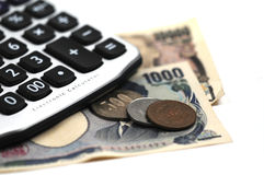 Business in Japan. A calculator and Japanese money Stock Photography