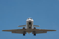 Business jet. On landing approach against a clear blue sky Royalty Free Stock Image