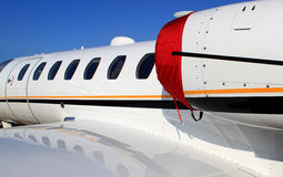 Business jet. Close up view of aircraft windows Stock Photo