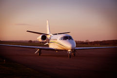 Business Jet. A Business Jet parked on the ramp at sunset Royalty Free Stock Photo