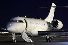 Business jet airplane at night. Business jet airplane standing at parking at night Royalty Free Stock Photography