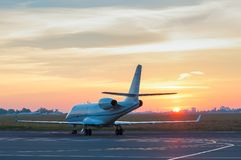 Business jet on the apron of aircraft. Dawn at Stock Photo