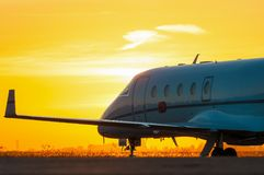 Business jet on the apron of aircraft. Dawn at Stock Images