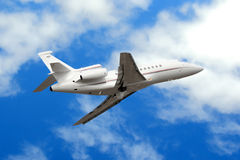 Business jet in clouds Stock Photos